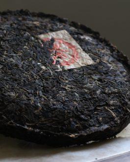 2003年鐵餅紅印普洱圓茶